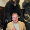 James Neiss/staff photographerNiagara Falls, NY - Local big game hunter and businessman John L. Hutchins stands next to a trophy Yukon Grizzly Bear in his Niagara Falls business office. Hutchins is opening a new campground called Bear Creek near Ellicottville in late summer.