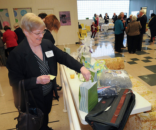 James Neiss/staff photographerNiagara Falls, NY - Janet Markarian of Niagara Falls places basket auction tickets at the Heart Love and Soul 30th Anniversary Celebration.