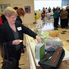 James Neiss/staff photographerNiagara Falls, NY - Janet Markarian of Niagara Falls places basket auction tickets at the Heart Love and Soul 30th Anniversary Celebration.