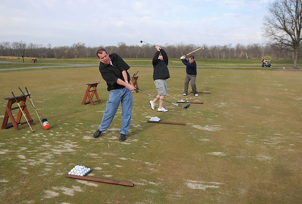 """James Neiss/staff photographerLewiston, NY - Driving """"Range"""" of Motion: Golfing buddies, from left, Doug Williams, Tom Hanna, both of Niagara Falls, and Tony Dean of Wheatfield, show off a range of motion in their swings as they practice driving before their tee time at the Seneca Hickory Stick golf course."""