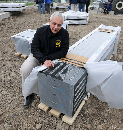 James Neiss/staff photographerNiagara Falls, NY - David Fabrizio, chairman of the Niagara Falls Veterans Memorial Committee shows of an ornate piece of granite for the Niagara Falls Veterans Memorial at Hyde Park. Workers, said it should take about a week to complete.