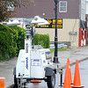 120430 Enterprise 2 James Neiss/staff photographerNiagara Falls, NY - A headless light pole stands behind temporary portable lighting on Pine Avenue between 24th Street and Hyde Park Boulevard as work on the street lighting begins.