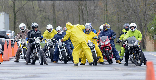 James Neiss/staff photographerWheatfield - Rider Coach Justin Eulrich of the Mac Street Rider motorcycle safety program, center, puts his class through a simulated practice as they all lean in his direction. The outdoor class takes place in the old Bell Aerospace parking lot at the corner of Niagara Falls Boulevard and Walmore Road.