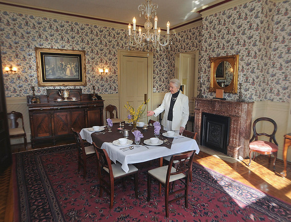 James Neiss/staff photographerNiagara Falls, NY - Tatler Inc. club President Beth Waters shows off the dining room at the Porter Mansion on 4th Street.