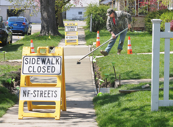 James Neiss/staff photographerNiagara Falls, NY - It was a bright sunny day on Wednesday as Jason Kleim of the Niagara Falls DPW sidewalks department puts the finishing touches on a new sidewalk in the 2600 block of Niagara Avenue.