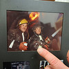 James Neiss/staff photographerNiagara Falls NY - New Niagara Falls Fire Chief Tom Colangelo holds a photo, circa 1987, with his brother Battalion Chief Greg Colangelo at one of Tom's first big fires as a firefighter in Niagara Falls.
