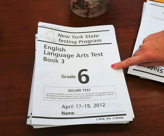 James Neiss/staff photographerNiagara Falls -  Faculty at Niagara Street Elementary organize state tests.
