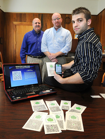 James Neiss/staff photographerNiagara Falls, NY - Niagara County Community College Recreation Studies Coordinator Budd Termin, left, Director of Niagara Falls State Parks Ron Peters and NCCC Student Tony DiCosmo teamed up to create a QR (Quick Response) Bar Code system for the park titled Operation Park-Code. By scanning a QR Barcode with a common smartphone, tourists can get information about the location they are visiting.
