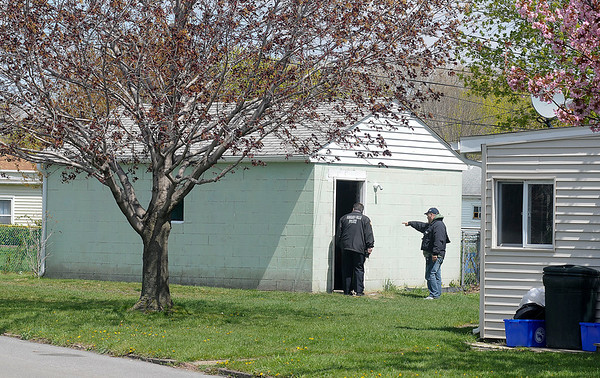 James Neiss/staff photographerNiagara Falls, NY - Niagara Falls Police Officers inspect a garage on A Streets where they discovered a suspected meth lab, the first to be found in Niagara Falls.