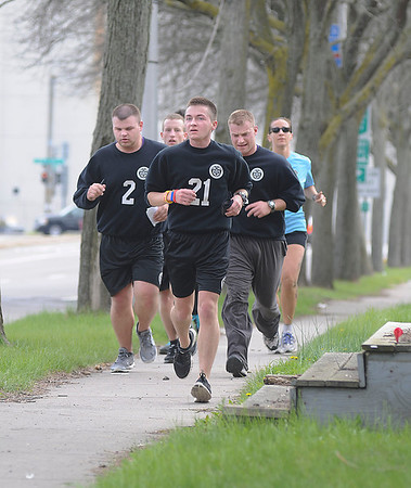 James Neiss/staff photographerNiagara Falls, NY - Students from the 53rd class of the Niagara County Law Enforcement Academy run along Rainbow Boulevard  under the guidance of instructor and Niagara Falls Police Officer Tina Zell. The group was one of several teams participating in a scavenger hunt type drill, where they had to determine the location of several colored bands around the south end of the city, based on a sheet of clues each team was given at the start of the race.