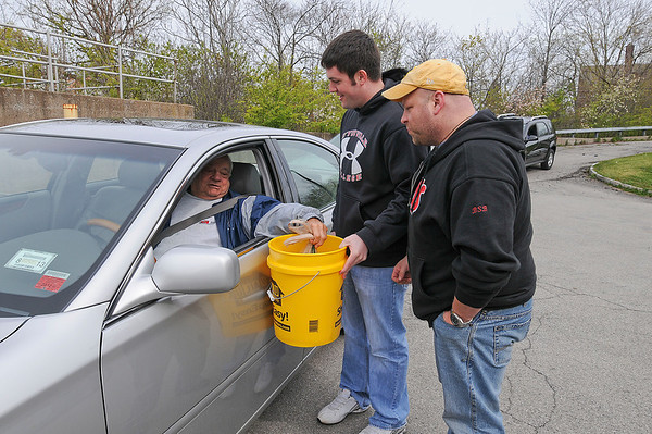 James Neiss/staff photographerNiagara Falls, NY - D'Youville Pharmacy majors Ryan Wagner, center, and Jacob Bardak, right, collect unwanted pharmaceuticals from Frank Phillips of the Town of Niagara, left, at the old Public Safety Building on Hyde Park Boulevard. The Niagara Falls Police Department teamed up the the D'Youville Pharmacy School department to take part in National Prescription Drug Take-Back Day on Saturday.