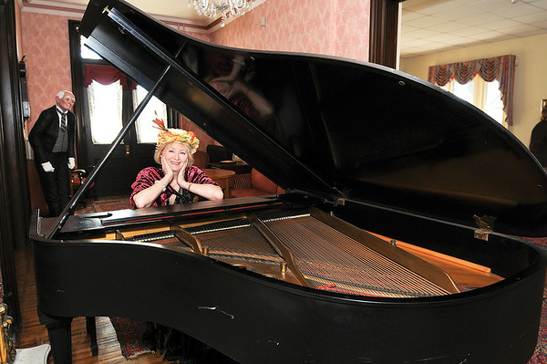 James Neiss/staff photographerNiagara Falls, NY - Member Jean Walker plays the piano for club events at the Porter Mansion, home of the Tatler Club.