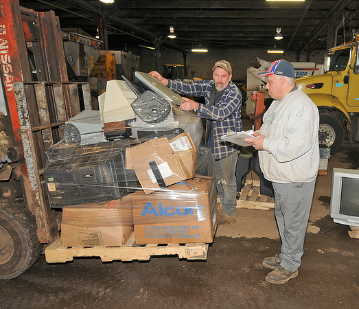 James Neiss/staff photographerNiagara Falls NY - City workers Paul Placek and Jon Fadel had to deal with pallets full of old electronics during the city electronic recycling day at the City Corporation Yard.