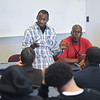 James Neiss/staff photographerNiagara Falls - Former student Cheron Hunt, 20, speaks to students at Niagara Falls High School about his life and brush with the law as part of Operation SNUG, a violence prevention program. SNUG Field Supervisor Michael Cole, listens at right.
