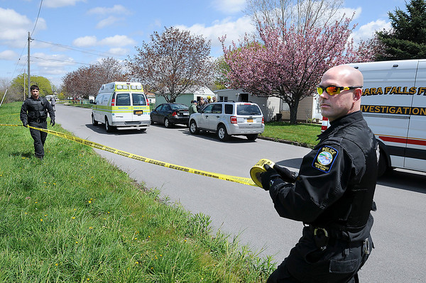 James Neiss/staff photographerNiagara Falls, NY - Niagara Falls Police Officers Kevin Maluchnik and Paul Warmington cordon off the area around a home at the corner of A and D Streets after police found a meth lab operation there, the first to be discovered in Niagara Falls.