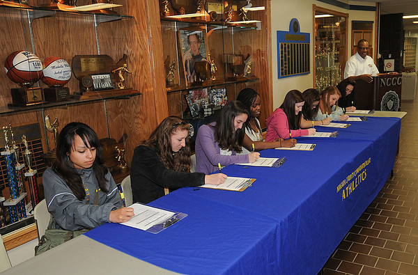 James Neiss/staff photographerNiagara Falls, NY - Niagara County Community College signs local high school students to their Women's Soccer program. From left are, Alana Humphrey of Buffalo, Erin Kraus of Cheektowaga, Victoria Zambuto of Rochester, Faye-Lynne Noel of Williamsville, Jessica Zinsmeister of Hamlin, Haylee Stopa of Niagara Falls, Katie Heeks of Rochester, Samantha Costanzo of North Tonawanda and Coach Anthony Massop.