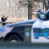 James Neiss/staff photographerNiagara Falls, NY - Niagara Falls Police Officer Wayne General draws his gun on a robbery suspect after a foot chase that ended up at a Hyde Park pavilion. Empire Auto Outlet on Niagara Falls Boulevard reported the robbery.