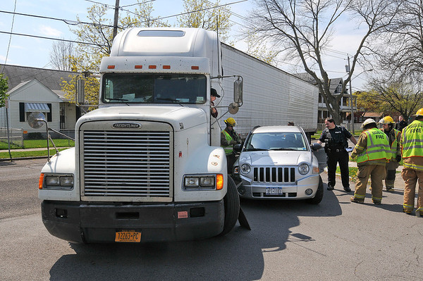 James Neiss/staff photographerNiagara Falls, NY - It appears that a truck caused a car to get wedged against it's trailer when it made a left hand turn onto 26th Street from the right lane of Ferry Avenue.