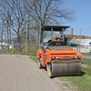 James Neiss/staff photographerNiagara Falls, NY - Operating Engineer Fran Bue rolls a baseball diamond at Hyde Park in preparation for the 2012 little league season.