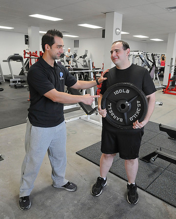 James Neiss/staff photographerNiagara Falls, NY -  Former Niagara Gazette City Editor Rick Forgione lost 100 pounds in one year with the help of personal trainer Christopher Tybor, owner of ChrisFit on Hyde Park Boulevard.