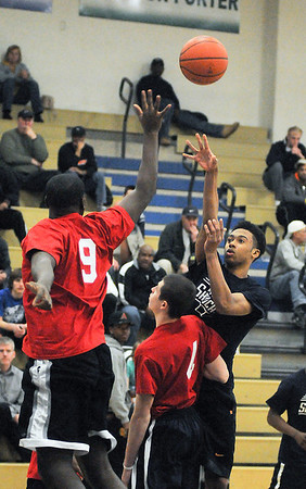 James Neiss/staff photographerNiagara Falls, NY - North Junior/Senior player # 3 Ramir Burton of Niagara Falls, shoots the ball during basketball game action against the South Junior/Senior team at the 2012 ACE/PAL Basketball Game.