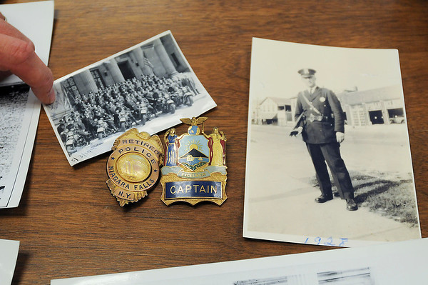 James Neiss/staff photographerNiagara Falls, NY - Niagara Falls Police Lt. Bryan DalPorto shows off some of the police artifacts he is organizing for display in the lobby of the Niagara Falls Public Safety Building.