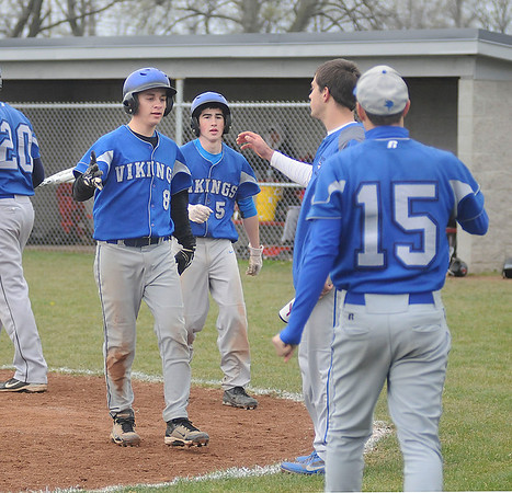James Neiss/staff photographerSanborn, NY - Grand Island #8 Jesse Ciffa and #5 Kevin Dobson are greeted by teammates after both made a run in the 2nd Inning of baseball game action against Niagara Wheatfield.