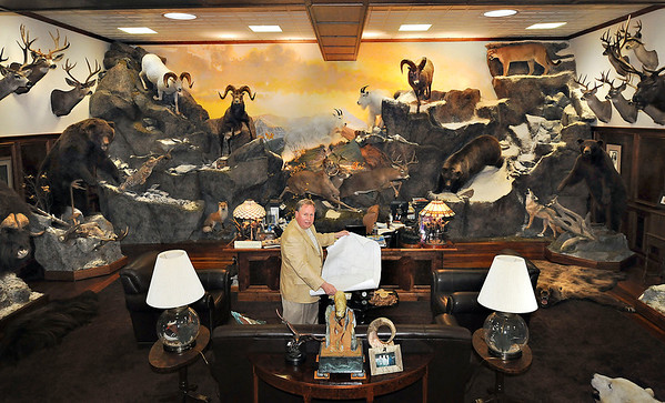 James Neiss/staff photographerNiagara Falls, NY - Local big game hunter and businessman John L. Hutchins made a trophy room out of his Niagara Falls business office. Hutchins enjoys the outdoors so much he's opening a new campground called Bear Creek near Ellicottville in late summer.