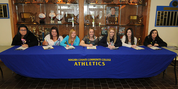 James Neiss/staff photographerNiagara Falls, NY - Niagara County Community College signs local high school students to their Women's Bowling program. From left are, Audrelle Gospodarski of Cheektowaga, Brooke Seiwell of Niagara Falls, Megan Maurer of Niagara Falls, Hannah Mosher of North Tonawanda, Jen Hojnowski of North Tonawanda, Jillian Philips of North Tonawnanda and Allison Marchesse of Tonawanda.