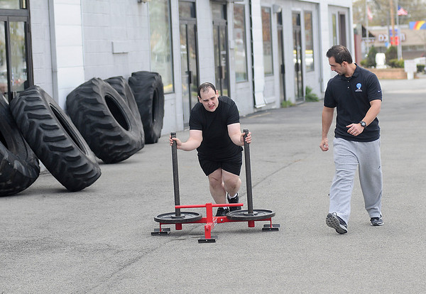 James Neiss/staff photographerNiagara Falls, NY - Personal trainer Christopher Tybor, owner of ChrisFit on Hyde Park Boulevard, puts former Niagara Gazette City Editor Rick Forgione through a grueling morning workout. Forgione lost 100 pounds in 1 year with Tybor as his personal trainer.