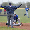 James Neiss/staff photographerSanborn, NY - Out of Reach: The umpire called Niagara Wheatfield baseball player #13 Anthony Oliveri safe at 2nd base as Grand Island player #9 John McGinty looks toward the unreachable ball during game action at Niagara Wheatfield.