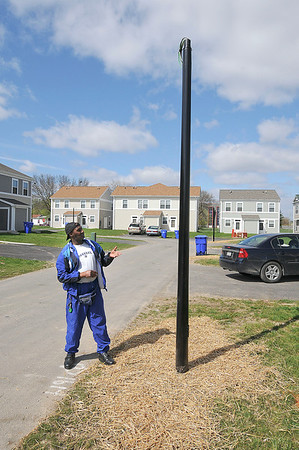"""James Neiss/staff photographerNiagara Falls, NY - Richey Moore, said he's glad to see the fixed street lights in place behind his Hope VI home. """"I especially think  these lights are especially important for the safety or the children in the area."""" he said."""