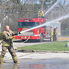 "James Neiss/staff photographerNiagara Falls, NY - Firefighter Micah Carey tests a hose line as Captain Scott Dunn operates the deck gun on top of a brand new Engine 8. The Niagara Falls Fire Department took delivery, Wednesday, of the 2011 Rosenbauer pumper truck. ""Engine 8 is capable of pumping 1500 gallons of water per minute and it's holding take will carry 750 gallons, said Fire Captain Scott Dunn. It will also take several weeks to outfit the truck with radios and equipment before it can be put into service."""