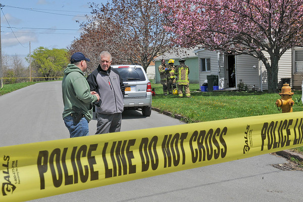 James Neiss/staff photographerNiagara Falls, NY -  Niagara Falls Police Superintendent John Chella, right, speaks with Lt. Bryan DalPorto at the cordoned off scene of a suspected meth lab on A Street.