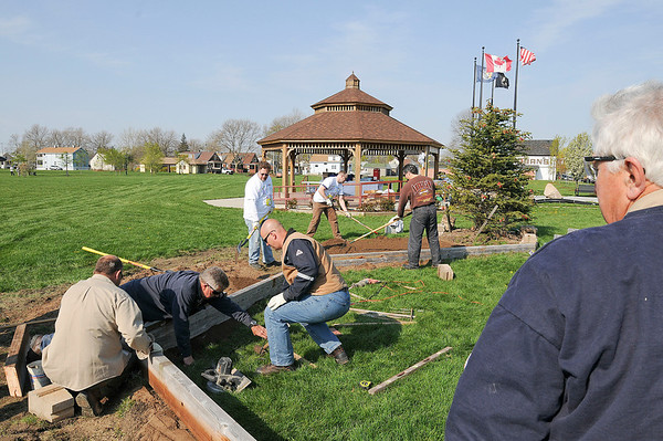James Neiss/staff photographerNiagara Falls, NY  -  National Grid volunteers joined the Niagara Street Business Association to add some landscaping at Gill Creek Park.