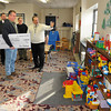 "James Neiss/staff photographerNiagara Falls, NY - YMCA Associate Director Angelo Tecchio, right, gives Jerry Talarico, second from right and Joe Meyers, center, both with Buffalo Fuel, a tour of the facilities.  Talarico and Meyers stopped by to drop off a check for $2000 to help kick off the ""Strong Kids Campaign"" next week. The money raised goes to families for membership, who otherwise would not be able to take advantage of all that the Y offers.  Last year the YMCA gave out $100,000 to area families. Jointing the tour, from left are, board member Michele Altman and Executive Director Greg Larson."