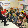 "James Neiss/staff photographerNiagara Falls, NY - Former LaSalle High and UB basketball player Modie Cox reads to children at Harry F. Abate Elementary as part of his ""Winning Because I Tried"" community outreach program."