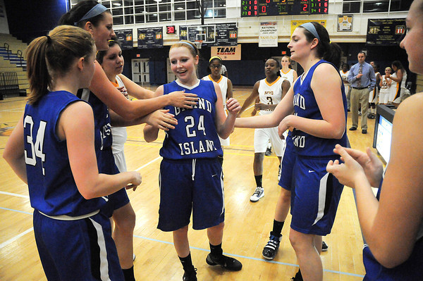 James Neiss/staff photographerNiagara Falls, NY - Grand Island Girls Basketball player Kallie Banker is honored by her teammates for surpassing both the boys and girls basketball scoring records for the school, during a game against Niagara Falls.