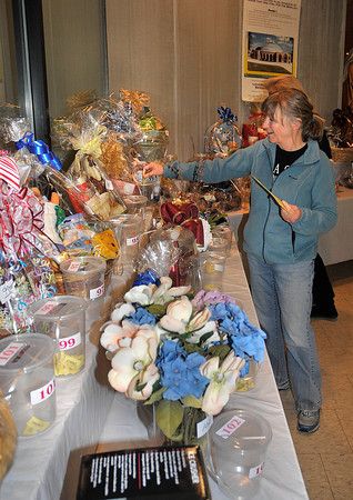 James Neiss/staff photographerLewiston, NY - Wendy O'Connor of Ransomville takes advantage of the basket preview night on Friday to drop a few tickets in hopes of winning at least one of the many baskets up for auction at the 7th Annual Festival of Lights Banquet & Auction on Saturday starting at 6 p.m.