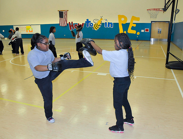 ames Neiss/staff photographerTown of Niagara, NY - Niagara Charter School fifth graders Genesis Smith, left, and Zhaynga Davis practice self defense moves they learned in gym class.