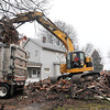 James Neiss/staff photographerWheatfield, NY - Charles VanEpps of Regional Environmental Demolition removes debris with an excavator after demolishing the condemned home 618 4th Street.