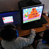 James Neiss/staff photographerTown of Niagara, NY - Kindergarten students at the Niagara Charter School work on their reading skills with the Reading Rabbit computer program.