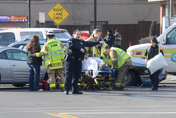 James Neiss/staff photographerNiagara Falls, NY - Emergency personnel deal with the aftermath of a two car accident at the intersection of Hyde Park Boulevard and Pine Avenue on Tuesday.