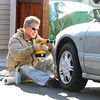 James Neiss/staff photographerLewiston, NY - Safety First: Tom Smith of Lewiston takes advantage of a mild January day to remove the haze from his daughters head lights outside their South 3rd Street home. Smith, said the special kit he bought did a good job of brightening up the lenses and that he was glad, because he's always concerned about his daughters safety while driving.