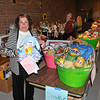 James Neiss/staff photographerNiagara Falls, NY - Niagara Catholic Special Events Coordinator Cindy Williams, left, and Director of Advancement Maureen Olson, show off just a few of the many baskets that will be available for the public to bid on at the Mardi Gras Dinner and Auction on Saturday, February 11, at Antonio's Banquet & Conference Center. Doors open at 5:00 p.m. for the silent auction bidding and viewing of baskets. Dinner is reservation only by calling 283-8771 ext. 242, but the public is invited to partake in the silent auction bidding.