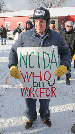 James Neiss/staff photographerNiagara Falls, NY - George Salerno of Lewiston, with Operating Engineers Local Union 463 shows his support during a rally on Saturday. Niagara County building trades protest the lack of local hiring for a $430 million Norampac construction project.