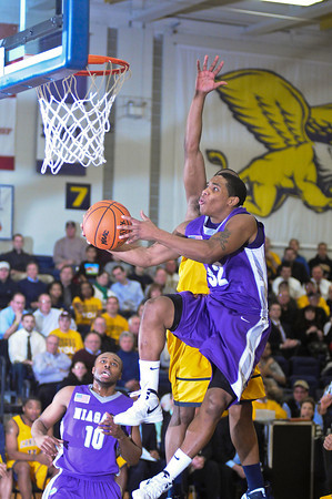 James Neiss/staff photographerBuffalo, NY - Niagara University #32 Marvin Jordan put the ball in during basketball game action at Canisius.