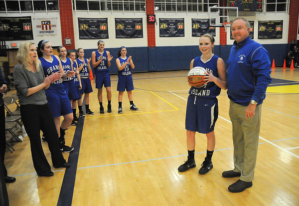 James Neiss/staff photographerNiagara Falls, NY - Grand Island Girls Basketball player Kallie Banker is honored by Athletic Director Jon Roth for surpassing both the boys and girls basketball scoring records for the school, during a game against Niagara Falls.