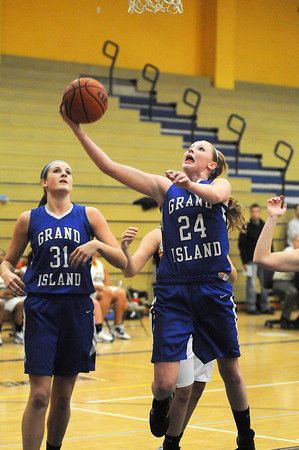 James Neiss/staff photographerNiagara Falls, NY - Grand Island Girls Basketball player Kallie Banker scores during a game against Niagara Falls where she surpassed both the boys and girls basketball scoring records for the school.
