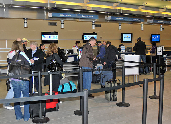 James Neiss/staff photographerWheatfield, NY - Passengers go through the ticket line at the Niagara Falls International Airport on Thursday. New York State Senator George Maziarz announced the creation of the International Airport Stakeholders Group, Inc., a not-for-profit organization that will work to promote the Niagara Falls International Airport during a press conference at the airport.
